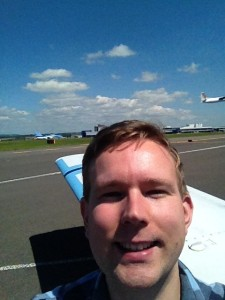 Selfie at Cardiff, see the departing plane in the background!?